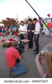 SAN BERNARDINO, CA - DECEMBER 6: News media cover a Jewish rabbi an his assistants at a makeshift memorial to IRC shooting victims on December 6, 2015 in San Bernardino, California.