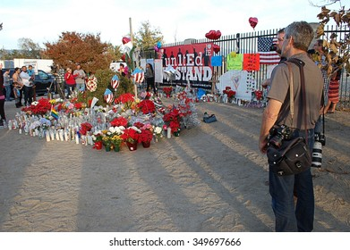 SAN BERNARDINO, CA - DECEMBER 6: News media covers the activities of visitors to a makeshift memorial to IRC shooting victims on December 6, 2015 in San Bernardino, California.