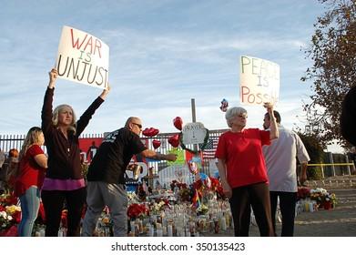 SAN BERNARDINO, CA - DECEMBER 6: Two women demonstrate at a makeshift memorial to IRC shooting victims on December 6, 2015 in San Bernardino, California.