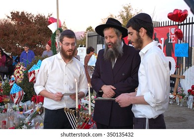 SAN BERNARDINO, CA - DECEMBER 6: Jewish rabbi and two assistants celebrate the first day of Hanukkah at a makeshift memorial to IRC shooting victims on December 6, 2015 in San Bernardino, California.