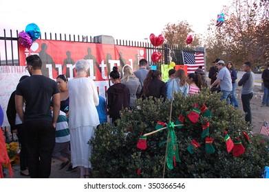 SAN BERNARDINO, CA - DECEMBER 6: People visit a makeshift memorial to IRC shooting victims on December 6, 2015 in San Bernardino, California.