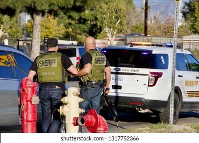 San Bernardino, CA / USA - December 2 2015: Police respond to a mass shooting at the Inland Regional Center. Rizwan Farook and Tashfeen Malik died in a shootout with police.