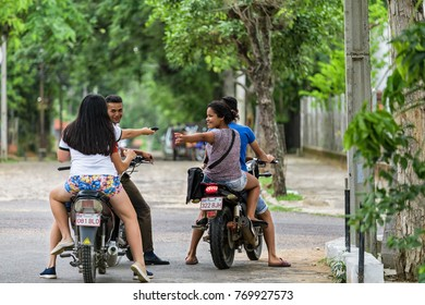 San Bernardino, Paraguay - 07 November, 2017: Four teenagers on motorcycles in San Bernardino-Paraguay