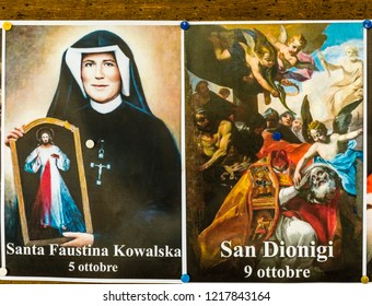 SAN BERNARDINO (RA), ITALY – OCTOBER 31, 2018: The priest put on the entrance of the church the images of the Saints to remind the religious connotation of Halloween