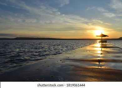 San Bernardino seaside resort a few kilometers from Asuncion, capital of Paraguay. Beautiful sunset on the beach of Lake Ypacaraí. Ideal for spending your holidays or a quiet weekend.