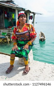 San Blas Islands, Panama - December 29, 2015: An unidentified Kuna Indian woman in native attire in the San Blas Islands.  The San Blas Islands include 365 islands and cays off the coast of Panama.