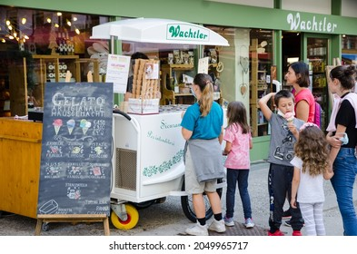 San Candido, Italy. SUmmer 2021. Children line up to buy ice cream from a walking cart