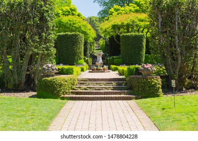 San Carlos, California, USA - May 05, 2019: A pathway in Filoli estate garden on sunny day with blue sky