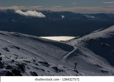 San Carlos de Bariloche, R'o Negro, Argentina: 7 30 2018; A lake is seen in the middle of the mountains in San Carlos de Bariloche.