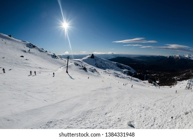 San Carlos de Bariloche, R'o Negro, Argentina: 7 30 2018; people skiing on a ski slope of Cerro Catedral are views