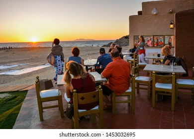 San Carlos, Mexico - Oct. 29, 2016: Tourists enjoy the sunset at San Carlos beach, San Carlos, Mexico.