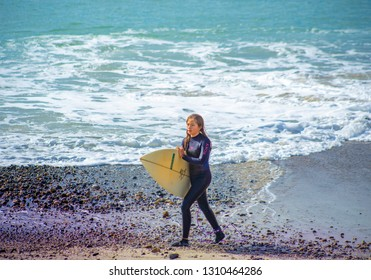 San clemente, CA / USA - FEB 2. 2019: Surfer Girl Contestant with Board