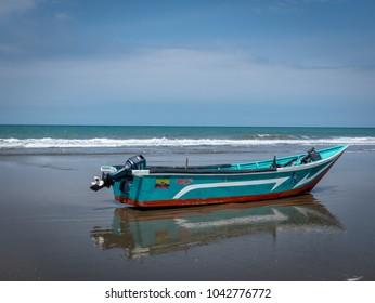 SAN CLEMENTE,MANABI, ECUADOR,  CIRCA JANUARY 2018  Fishing boat on shore circa  Jan 2018 in San Clemente Ecuador.The inshore or artisanal fishers are an important part of Ecuador cultre