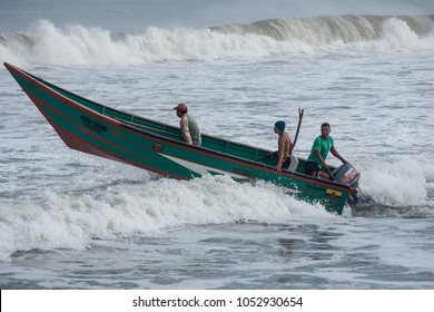 SAN CLEMENTE,MANABI, ECUADOR,  CIRCA JUNE 2015  Fishing boat traveling through the surf circa June 2015 in San Clemente Ecuador.The inshore or artisanal fisher are an important part of Ecuador culture