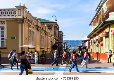 San José / Costa Rica - September 25, 2015: Pedestrians walk along the downtown historical area in the middle of the day.
