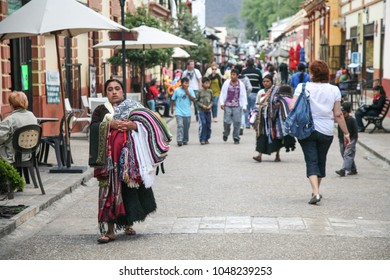 SAN CRISTOBAL DE LAS CASAS, MEXICO - March 7, 2012: Chiapas vendor woman srlling traditional clothes on a Pedestrian street in San Cristobal De las Casas, Mexico.