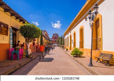 SAN CRISTOBAL DE LAS CASAS, MEXICO, MAY, 17, 2018: Unidentified people walking in a pedestrian street in san Cristobal de las Casas, Chiapas