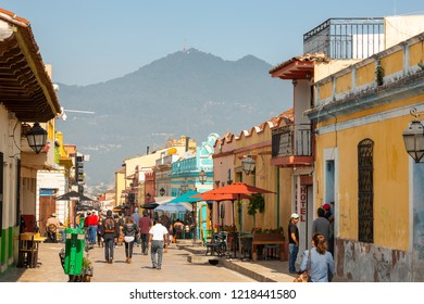 SAN CRISTOBAL DE LAS CASAS, MEXICO - MAY 25, 2018: Unidentified people walk along Real de Guadalupe in the tourist town of San Cristobal De Las Casas, Mexico.