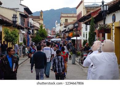 San Cristobal de las Casas, Mexico - July 13, 2015: People walking in pedestrian street. San Cristobal de las Casas, Chiapas, Mexico.