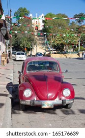 SAN CRISTOBAL DE LAS CASAS, MEXICO - FEBRUARY 7, 2013: VW Beetle parked in a street in San Cristobal de las Casas, Mexico, on a sunny day