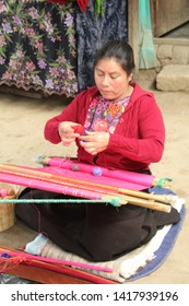 San Cristobal, Mexico - April 17, 2019: Woman weaving in a Mexican village market place.
