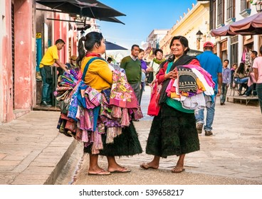 SAN CRISTOBAL, MEXICO-DEC 13, 2015:Tzotzil Maya people saling the traditional clothes at street of San Cristobal de las casas on Dec 13, 2015, Chiapas region, Mexico