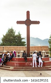 San Cristóbal de las Casas, Mexico - November 21, 2018:Large wooden cross on historic central square with local people