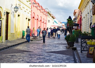 San Cristóbal de las Casas, Mexico - November 21, 2018: Traditional street with local people with colorful houses