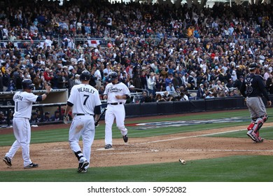 SAN DIEGO - APRIL 11: Adrian Gonzales scores during the 4th inning at PetCo Park April 11, 2010 in San Diego, CA