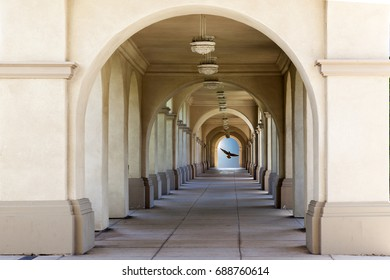 San Diego Balboa Park museum archway with bird glowing in the blue sky background,