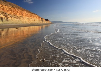 San Diego beach near a tall sandy cliff