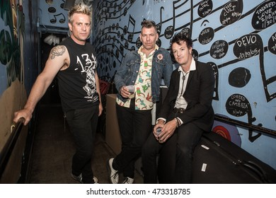 SAN DIEGO, CA - AUGUST 18: Andy Strachan, Scott Owen and Chris Cheney of The Living End pose for a portrait backstage at House of Blues on August 18, 2016 in San Diego, California.