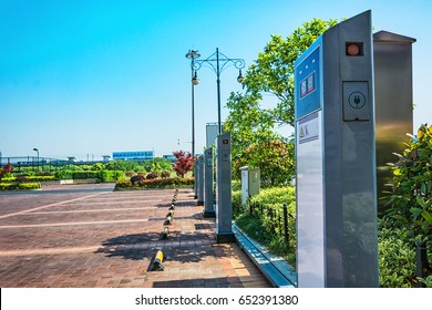 SAN DIEGO, CA - JANUARY 29, 2014: Solar powered electric vehicle car charging station in a public parking lot in California.