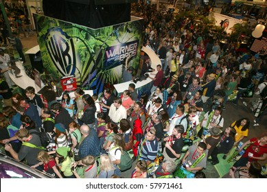 SAN DIEGO, CA - JULY 21: Comic Con attendees mob the Warner Brothers booth on the convention floor July 21, 2010 at the 2010 Comic Con International held in San Diego, CA.