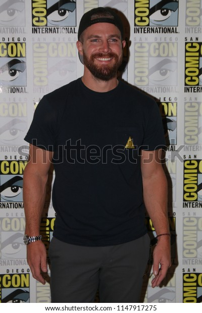 San Diego, CA - July 21, 2018: StephenAmell of The CW's Arrow arrives at Comic Con 2018 in San Diego, CA.