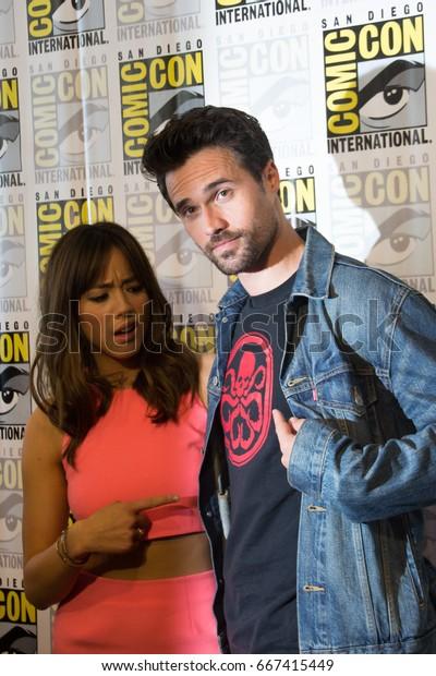 San Diego, CA - July 25, 2014: Chloe Bennet and Brett Dalton of Marvel's Agents of S.H.I.E.L.D. arrives at Comic Con 2014 in San Diego, CA.