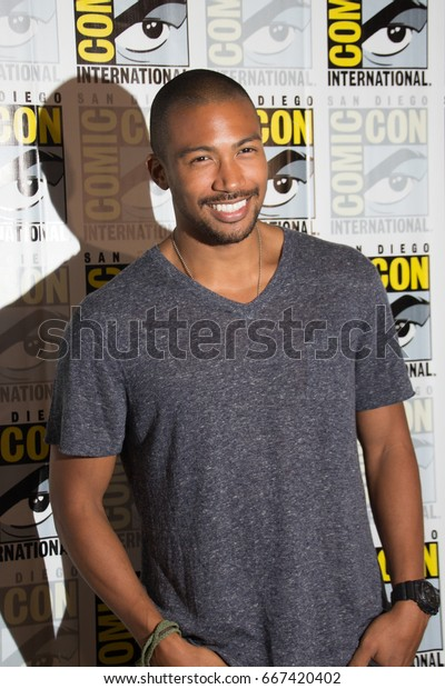 San Diego, CA - July 25, 2014:  Charles Michael Davis of The CW's The Originals arrives at Comic Con 2014 in San Diego, CA.