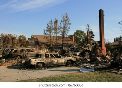 "SAN DIEGO, CA - OCTOBER 28: Homes & cars lie in ruins on October 28, 2007 after being destroyed by the ""Witch Fire"" in San Diego, CA. It is one of the largest & most destructive wildfires in San Diego history with about 1,500 homes and over 500,000 acres"
