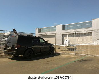 San Diego, CA - September 2 2019 : A private small jet and a limousine type vehicle. The driver of the car owns the private jet. Jet is parked before the car. Luxury concept and copy space.