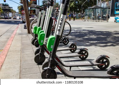 San Diego, CA / USA - 09/14/2018: Bird Electric Ride Sharing Scooters Lined Up and Ready to Rent
