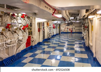 San Diego, CA, USA - 5th of July 2013: Inside the USS Dolphin submarine, at the Maritime Museum of San Diego. Hallway with remote hydraulic valve operators on the left.