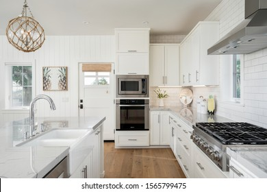 San Diego, CA / USA - 9/3/2019: Beachy kitchen design with shaker cabinets