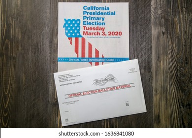 San Diego, CA / USA - February 5, 2020: View of election balloting material envelope and California Presidential Primary Election Official Voter Information Guide. Tuesday, March 3, 2020.