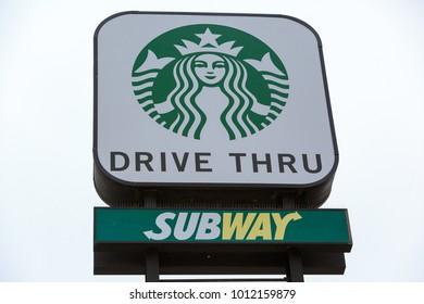 SAN DIEGO, CA, USA - JAN 15, 2018: Drive Thru Sign of Starbucks and Subway restaurants logo.