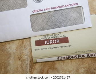San Diego, CA USA - July 5, 2021: View of a jury duty summons and envelope. Juror paperwork.
