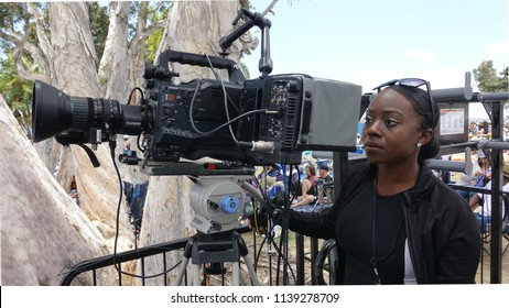 San Diego, CA / USA - June 30, 2018: A rare female camera operator in a male-dominated industry