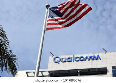 San Diego, CA / USA - March 16, 2018: US government cancels the Qualcomm-Broadcomm deal. Picture of the Qualcomm headquarters building at San Diego, CA with USA flag on a sunny day with blue sky.