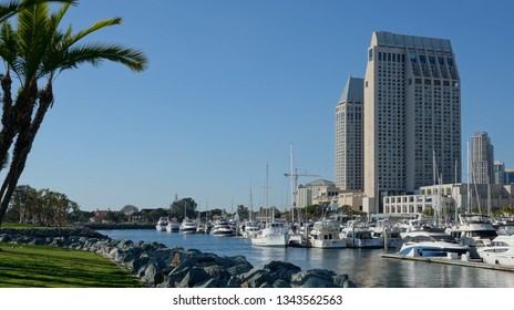 San Diego, CA / USA - March 18, 2019: The prominent towers of the Manchester Grand Hyatt hotel seen from across the San Diego Marina