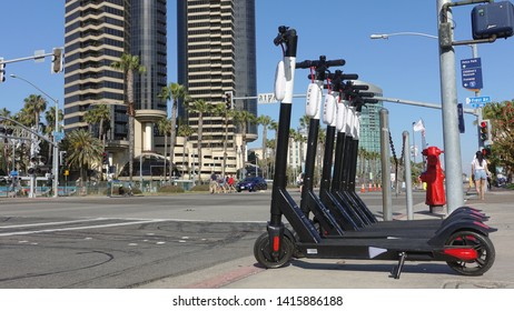 San Diego, CA / USA - May 31, 2019: A row of BIRD electric scooters parked in downtown San Diego