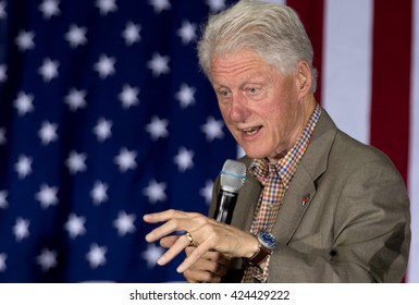 San Diego, CA, USA - May twenty first, 2016: Bill Clinton and supporters at Hillary Clinton Presidential rally, speech and shake hands